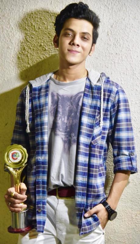 Vishal Jethwa Posing with His Award